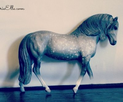model horse with broken leg