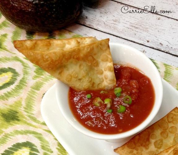 Wonton dipped in salsa