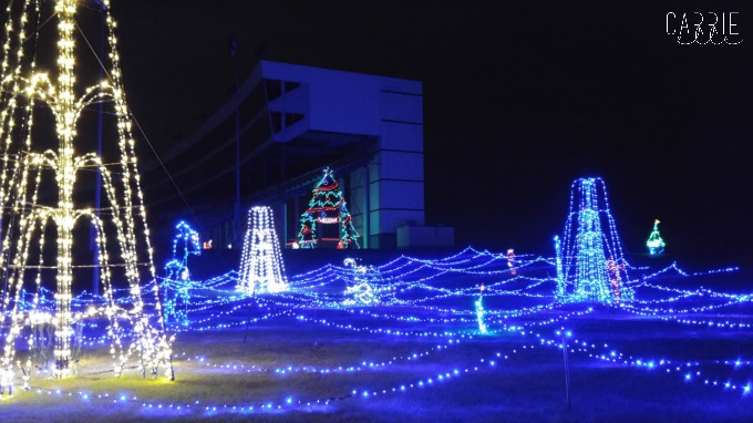But before you drive through the light show, you're going to want to stop  by Santa's Village with the kids. - Gift Of Lights At Texas Motor Speedway - Carrie Elle