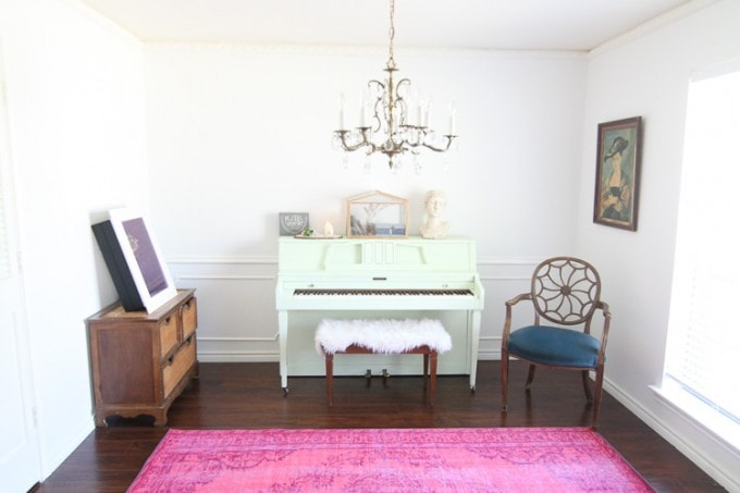 This-room-is-filled-with-my-favorite-colors-mit-white-and-pink-I-love-that-painted-piano-and-pin-rug.-3-of-9