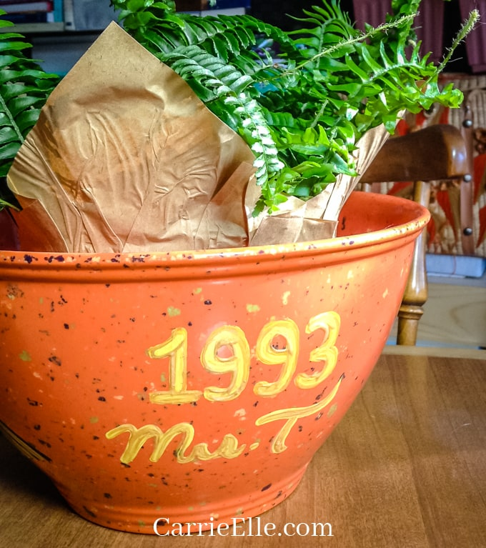 Photo of flower pot with teacher's name and year on side