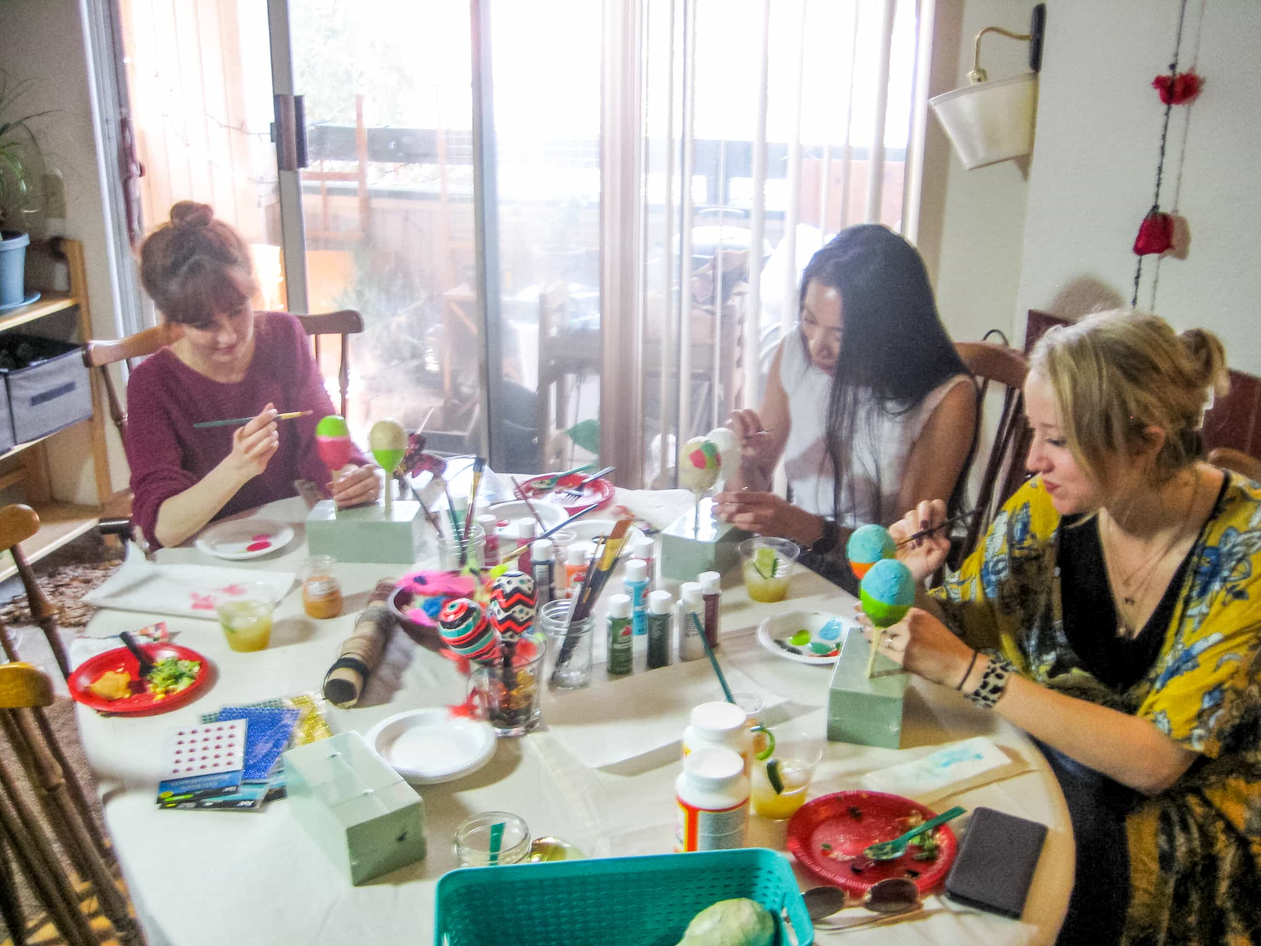 Photo of girls painting maracas at craft table