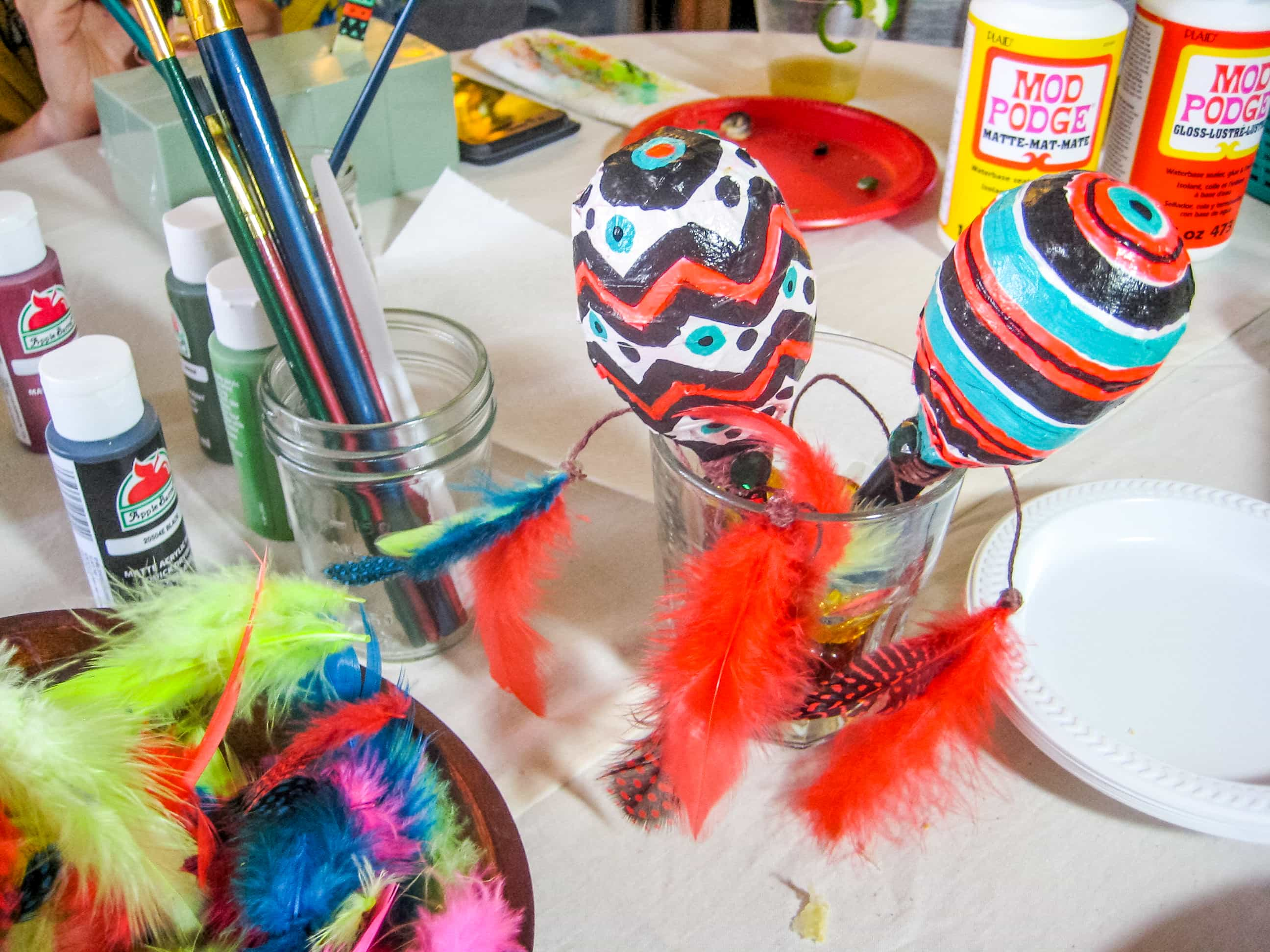 Brightly colored Maracas on a craft table