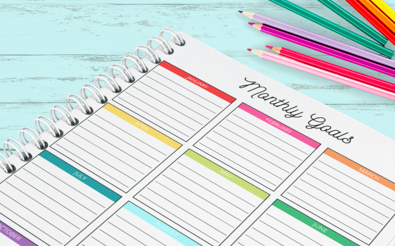 Featured image showing the printed monthly goal tracker ready to use!